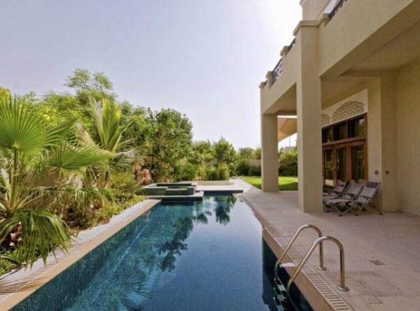 A sparkling villa lap pool