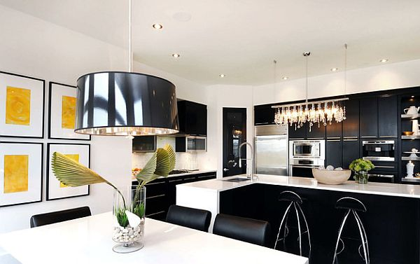 black and white kitchen with yellow wall art