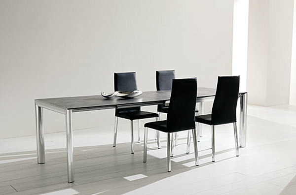 dark wooden expandable table with metal legs