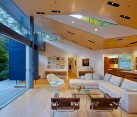 Highly modern open living room design with glass wall / by Griffin Enright Architects