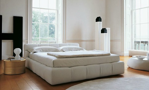 A modern Italian tufted bed