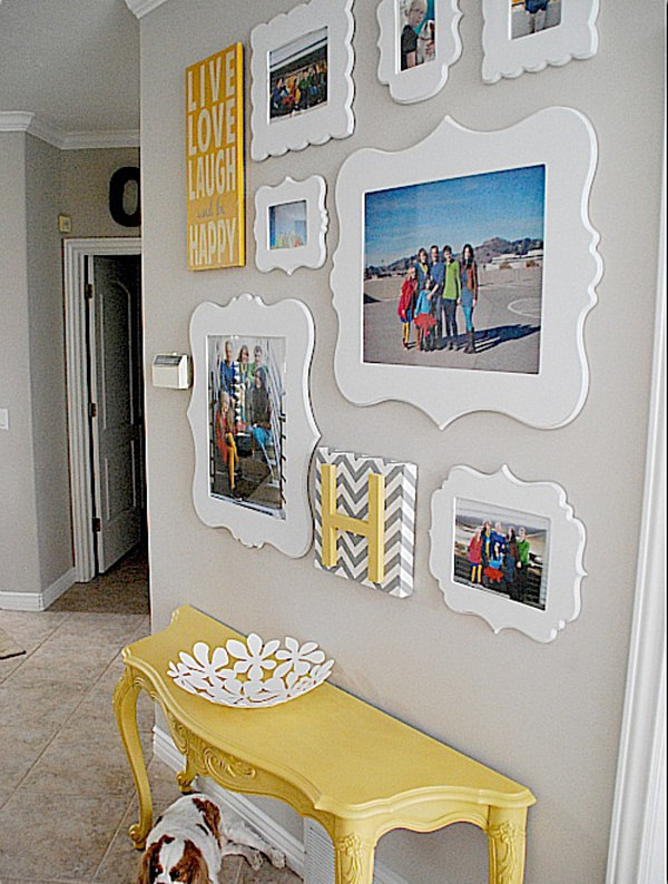 wall gallery of white framed family photos