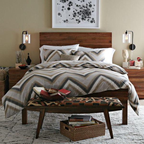 A bedroom featuring modern chevron bedding