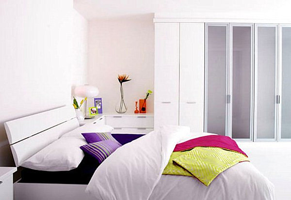 A bright bedroom with a storage closet