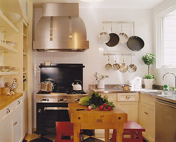 A bright kitchen with wall-mounted pots
