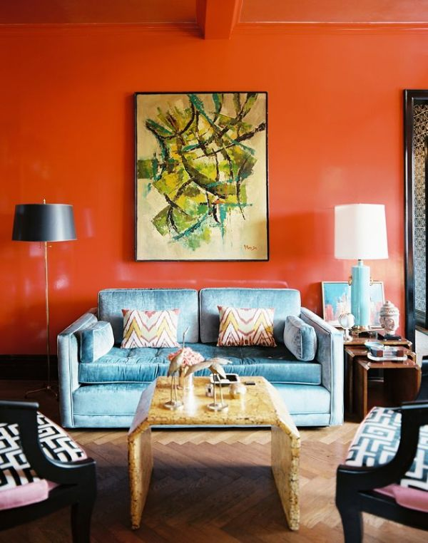 A bright orange living room Find Your Homes True Colors With These Living Room Paint Ideas