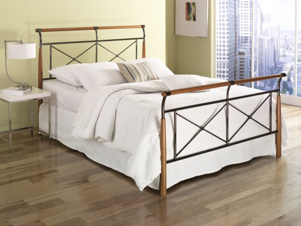 A contemporary metal and wooden bed