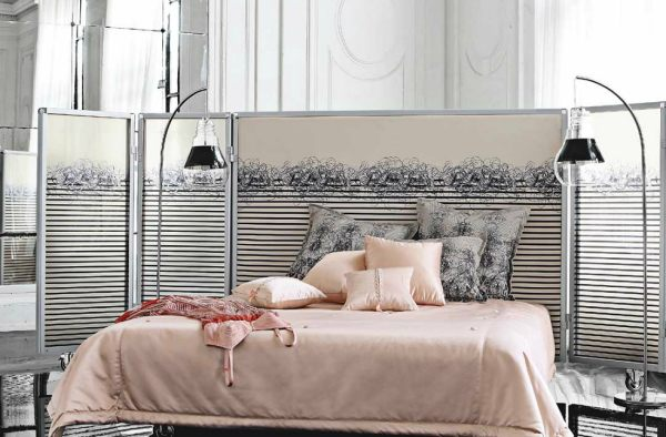 A designer metal screen bed by Jean Paul Gaultier