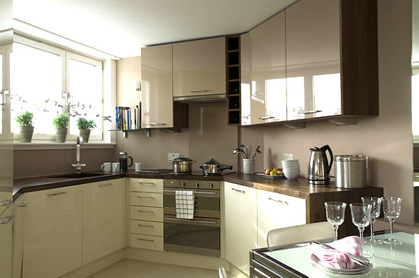 A kitchen with gleaming cabinets