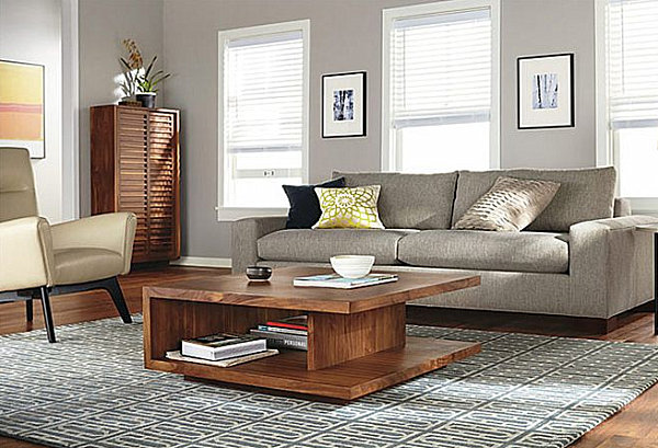 A living room with a coffee table that provides storage