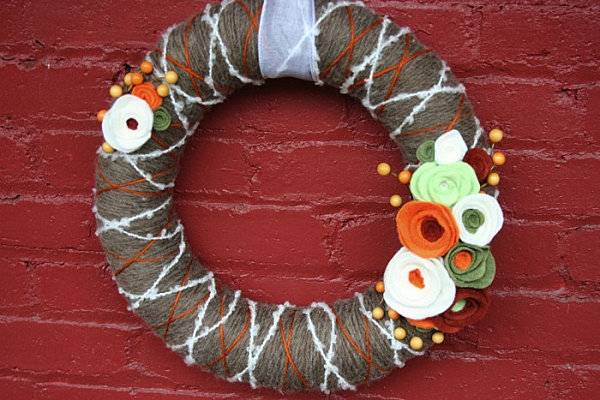 A modern yarn and felt wreath