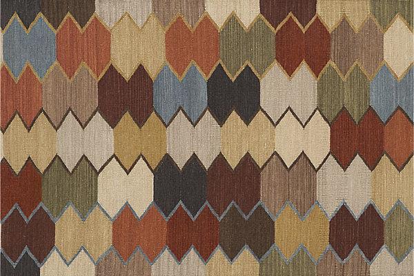 A modern geometric rug in autumn colors