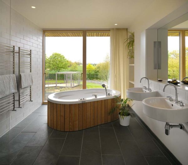 A modern oval tub with wooden detail