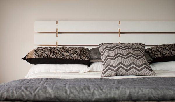 View in gallery A modern plywood headboard