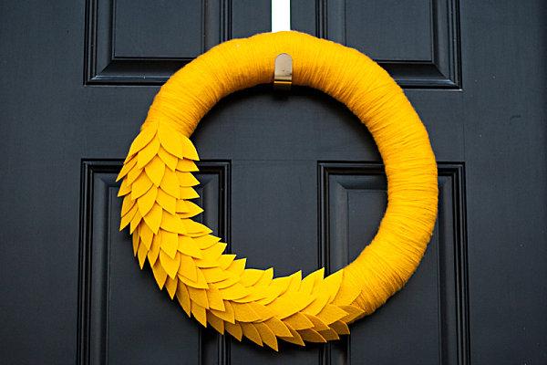 A monochromatic fall yarn and felt wreath