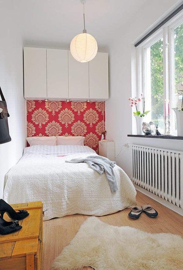 A small bedroom featuring bright wallpaper