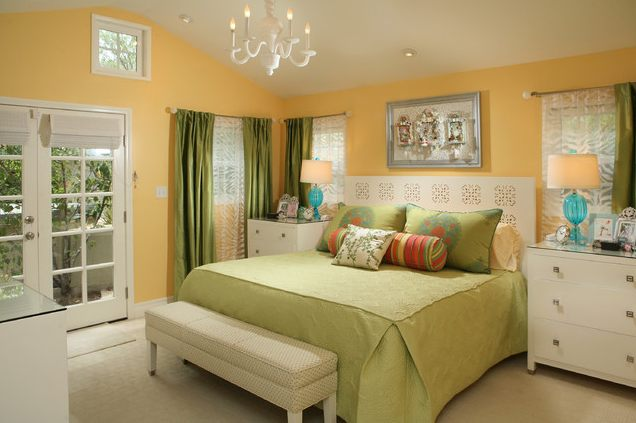 A small golden yellow bedroom