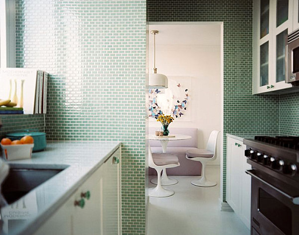 A small kitchen with green tile
