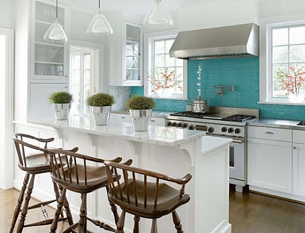 A turquoise tiled kitchen
