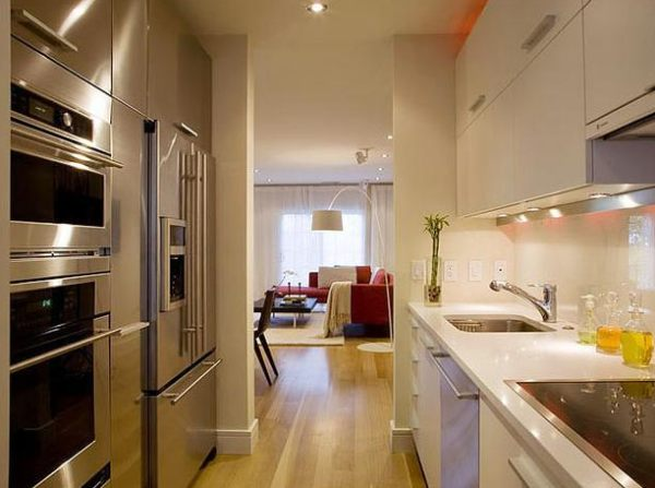 Wall Of Stainless Steel Appliances In A Galley Kitchen