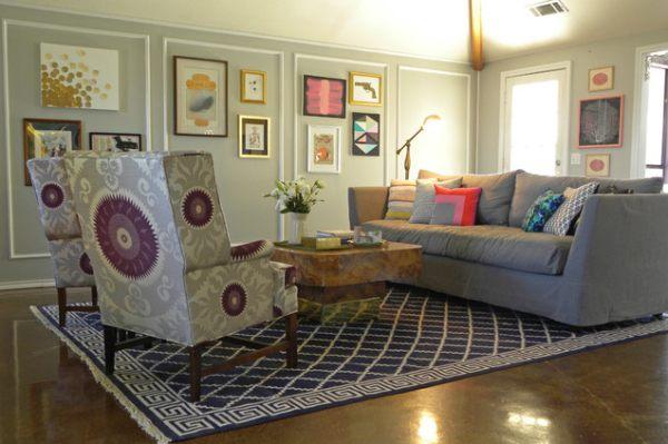 An artistic living room full of framed art and pillows