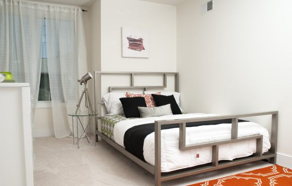 An industrial bedroom with Hollywood Regency accents