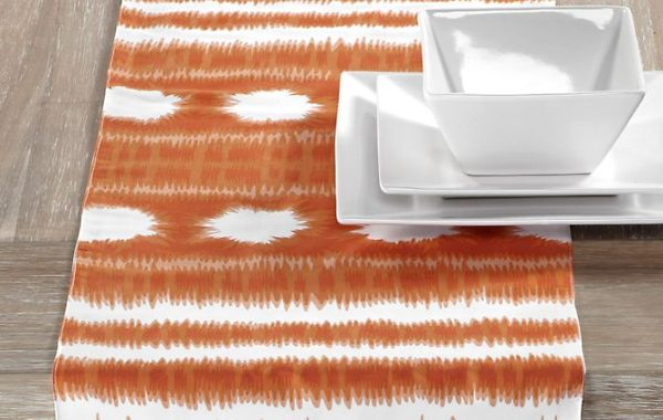 An orange and white table runner
