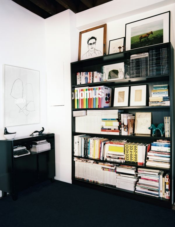 Art displayed on a bookshelf Off the Wall: Displaying Art When Wall Space Is Scarce