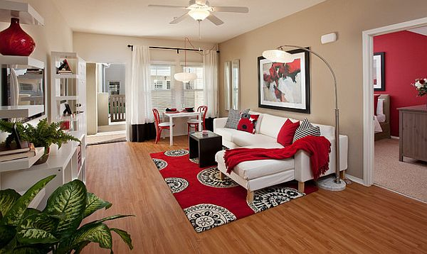 red in a modern living room bedroom decorating with red rugs and red
