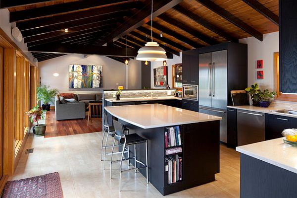 Black kitchen furniture with white glossy countertop 3 Overlooked Projects that Will Add Value to Your Home