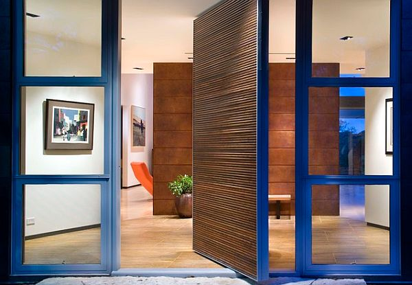 Blue glassy front door for a modern home