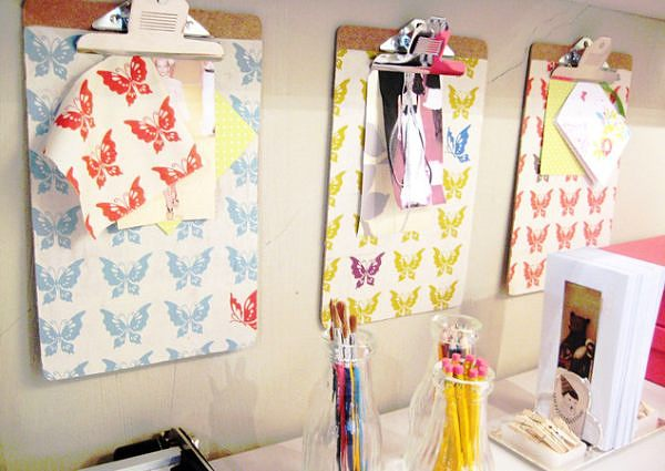 Clipboards secure fabric and pictures in a home office