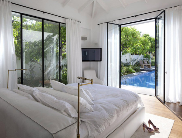 Glass Private House – all white bedroom with garden view
