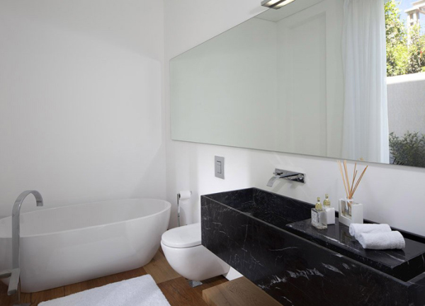 Glass Private House – black and white bathroom