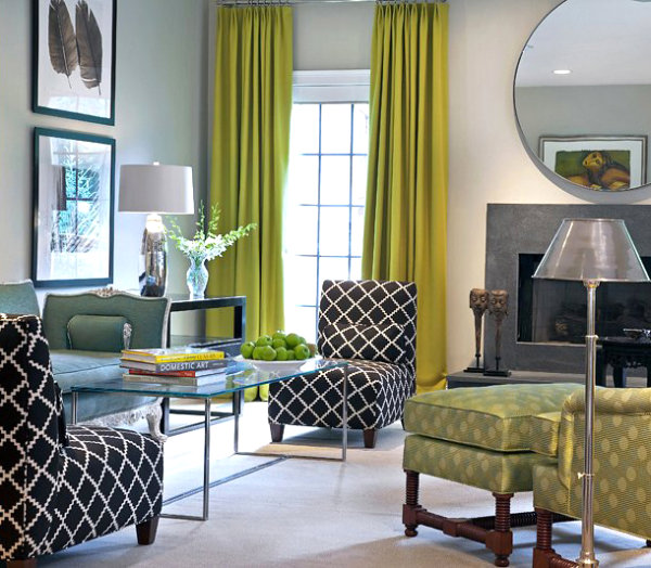 Green curtains set a vibrant tone in the living room
