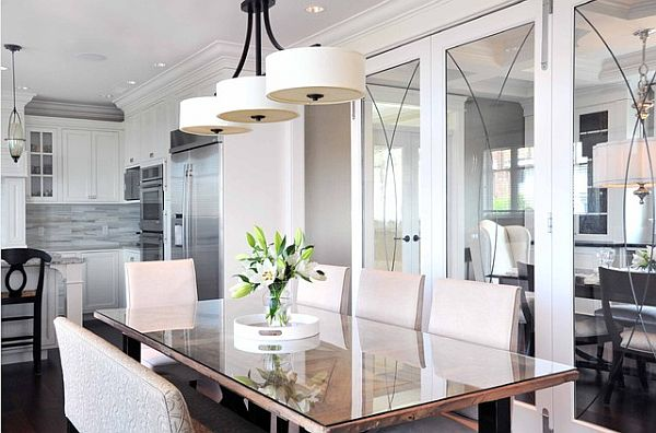 Modern dining table with glass top flowers and beautiful lighting fixture How to Transform a Room with One Feature