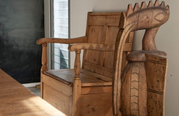 Original furnishings include antique pine settee and African wood sculpture