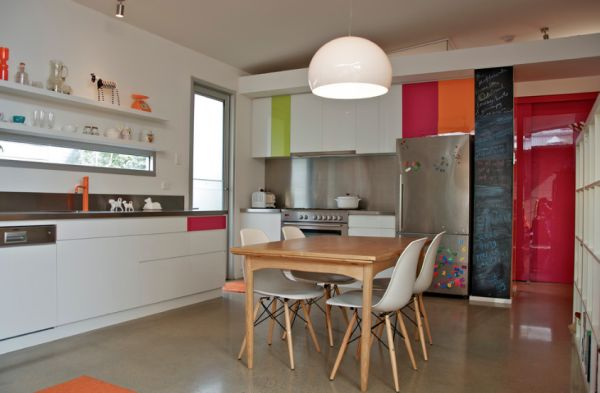 Sleek kitchen with stainless steel counter tops Revamped Green Home in the Heart of Adelaide Blends Rustic with Modern
