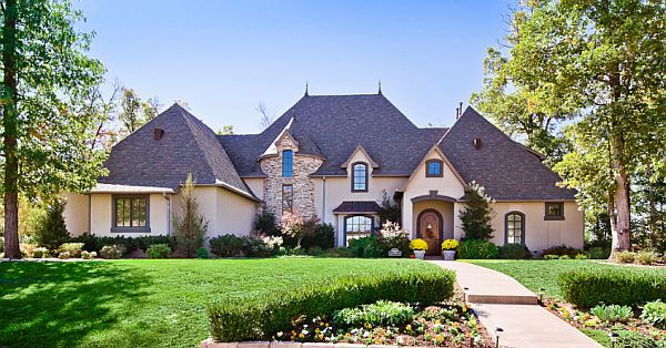Stucco and Stone exterior on this Old World home The 5 Things Every New Home Needs
