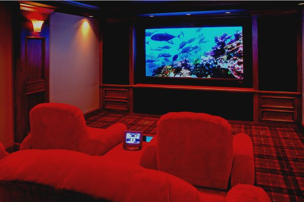 Ultra Modern Compact Media Room with Red and Blue accents