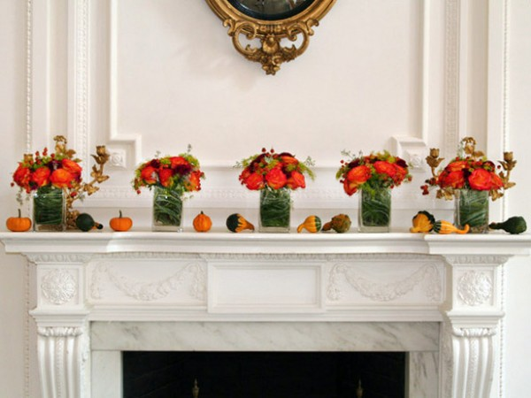 fireplace mantle small pumpkins e1347482110673 Warm Ideas for Your Autumn Fireplace Mantel