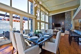 High ceiling contemporary dining room with fancy square table