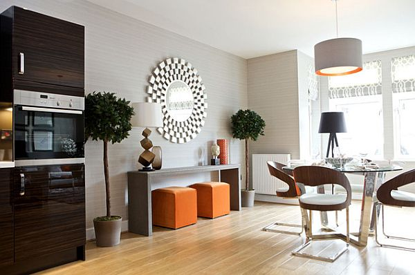 Modern living room furniture and a sunburst mirror hot home trend