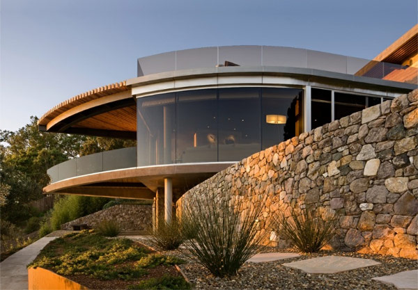 round glass wall Pristine Interiors and Great Ocean Views for the Coastlands Residence in California