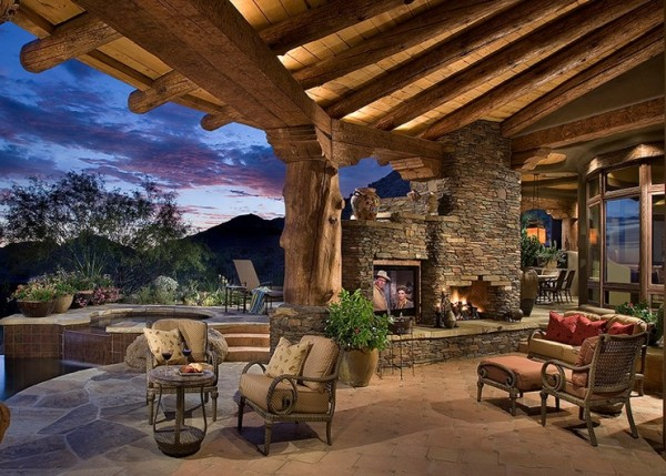 rustic outdoor porch fireplace tv