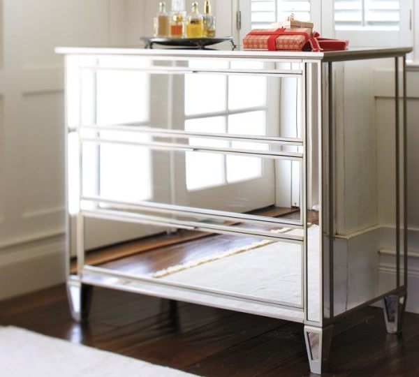 A 3-drawer mirrored dresser