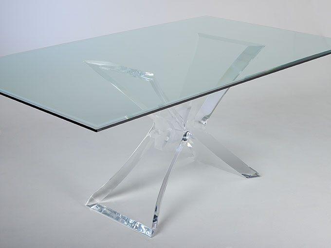 A clear acrylic dining table