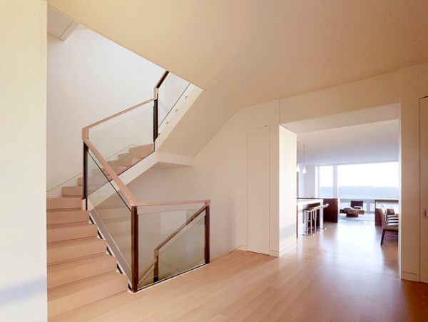 A glass and wooden handrail