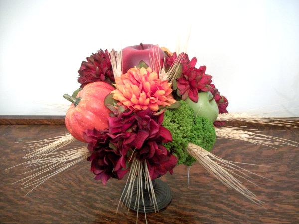 A hydrangea, fruit and wheat centerpiece