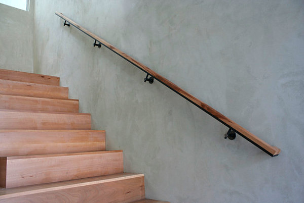 View in gallery A simple and sleek wooden handrail